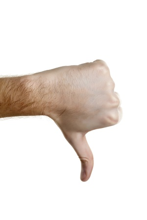 Image of thumbs down sign against white background photo