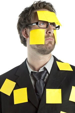 tired businessman: Portrait of tired businessman with sticky notes looking away on a white background Stock Photo