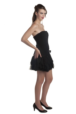 prom queen: Portrait of young attractive girl wearing black dress against white background Stock Photo