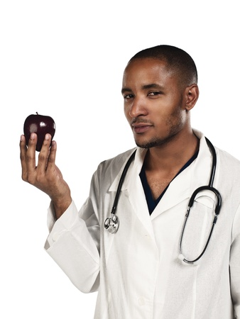 Portrait of a confident young doctor looking at an apple, Model: Kareem Duhaney Stock Photo - 17111446
