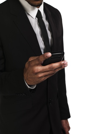 Mid section of a businessman texting on cellphone, Model: Kareem Duhaney Stock Photo - 17099839