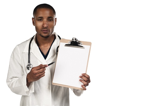 African American doctor pointing towards his clipboard over white background, Model: Kareem Duhaney Stock Photo - 17110641