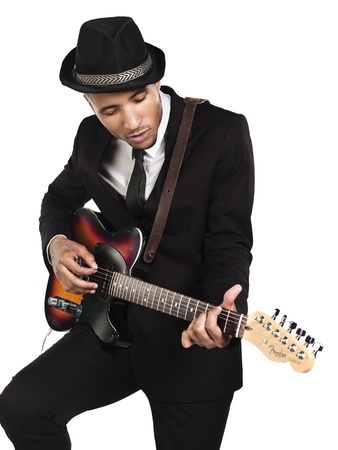 African American young businessman playing guitar over white background, Model: Kareem Duhaney photo