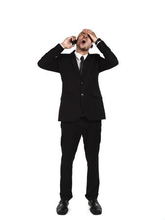Angry businessman talking on cellphone against white background, Model: Kareem Duhaney Stock Photo - 17110083