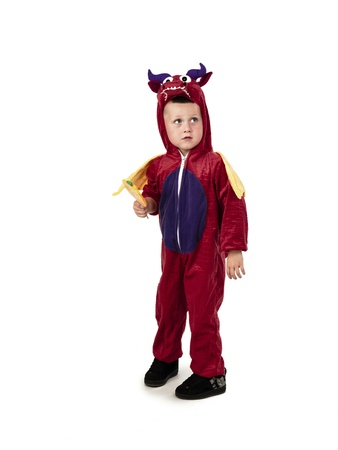 Young boy looks scared while wearing a costume.