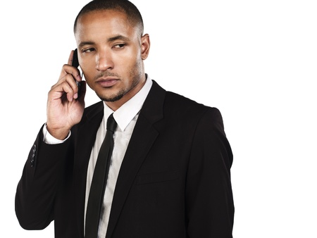 Businessman talking on the phone against whie=te background, Model: Kareem Duhaney Stock Photo - 17110684
