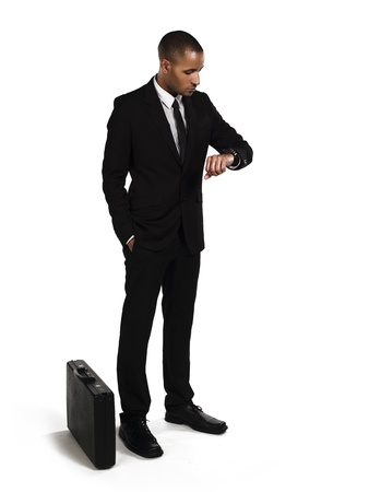 Young businessman waiting for someone over white background, Model: Kareem Duhaney Stock Photo - 17110078