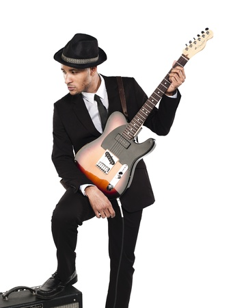 Businessman with guitar looking away against white background, Model: Kareem Duhaney Stock Photo - 17110213