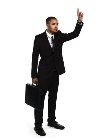 Business man gesturing while holding a briefcase against white background, Model: Kareem Duhaney photo