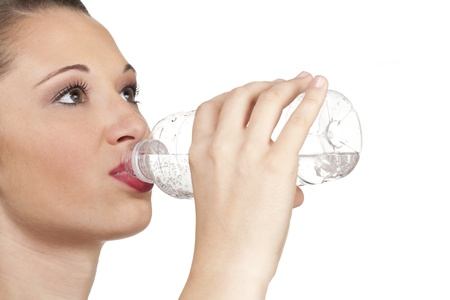 Closed up shot of a Caucasian woman drinking a bottle  of water