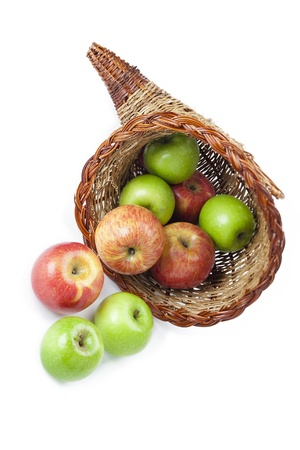 Close-up shot of wicker basket and apples over white background. Stock Photo - 17101041