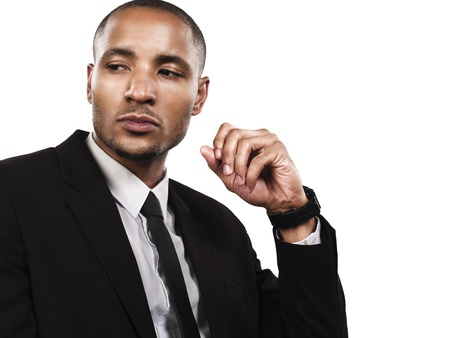Confident young business man looking away against white background