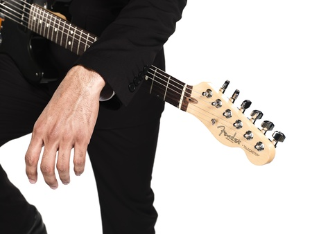 Cropped image of a business man with guitar over white background, Model: Kareem Duhaney Stock Photo - 17100283