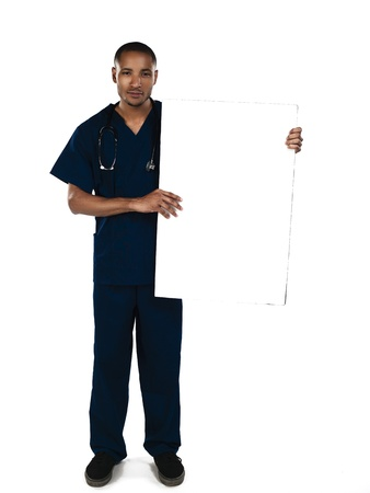 Doctor holding a blank white card isolated on white. Model: Kareem Duhaney photo