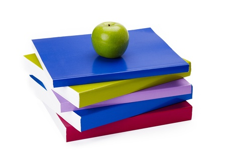 feeding through: Pile of books with apple on top interpreted as feeding the brain with knowledge through reading. Stock Photo