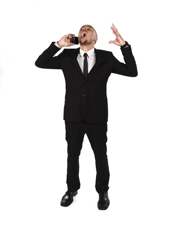 Frustrated businessman with cellphone over white background. Model: Kareem Duhaney Stock Photo - 17110084