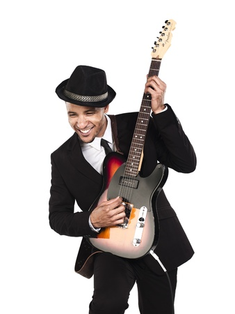 Happy businessman playing guitar agaisy white background, Model: Kareem Duhaney Stock Photo - 17110215