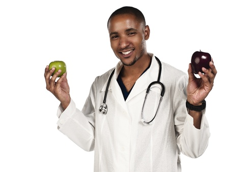 Happy doctor holding red and green apple over white background, Model: Kareem Duhaney Stock Photo - 17111152