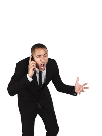 Image of a frustrated businessman with mouth open against white background. Model: Kareem Duhaney photo
