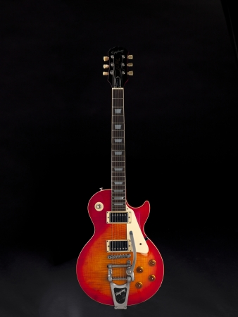 View of a red electric guitar over dark background. Stock Photo - 17100805