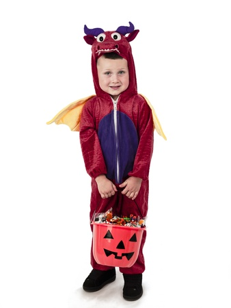 Kid in halloween costume carrying a bucket of goodies. Stock Photo - 17110166