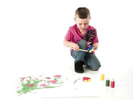 enrolled: Little boy enrolled in an art workshop is having fun.