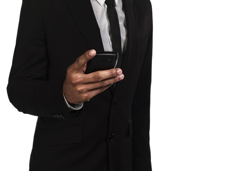 Midsection of a businessman text messaging on cellphone, Model: Kareem Duhaney Stock Photo - 17099805