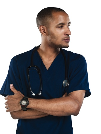 Close up of a male nurse folding his arms. Model: Kareem Duhaney photo