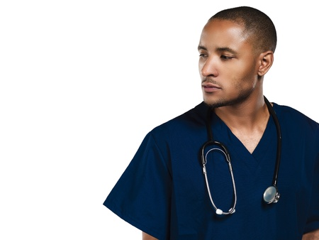 Nurse wearing a stethoscope and looking to the side with white background.  Model: Kareem Duhaney photo
