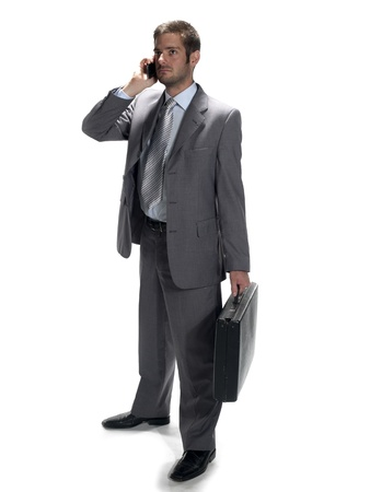 Shot of a man wearing a suit while on a cell phone. photo