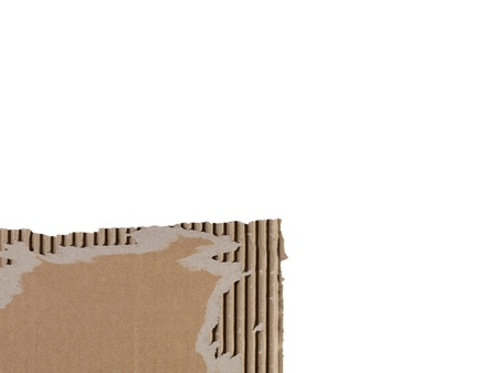 Close-up image of a piece of a brown torn carton on a white background Stock Photo