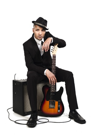 Portrait of a business man with guitar over white background, Model: Kareem Duhaney Stock Photo - 17110230