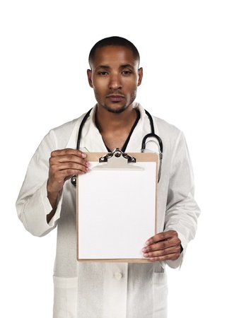 Portrait of a young doctor displaying his clipboard over white background, Model: Kareem Duhaney Stock Photo - 17110675
