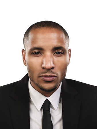 Portrait of a serious businessman against white bckground. Model: Kareem Duhaney Stock Photo - 17111470