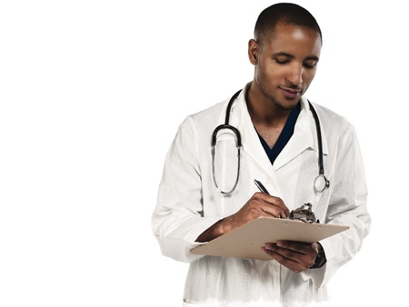 Smiling young doctor making notes against white background, Model: Kareem Duhaney Stock Photo - 17110639