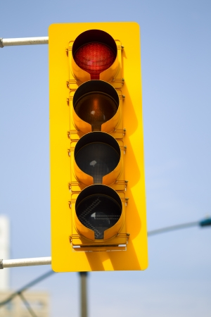 proceed: View of a traffic light with sky in the background.