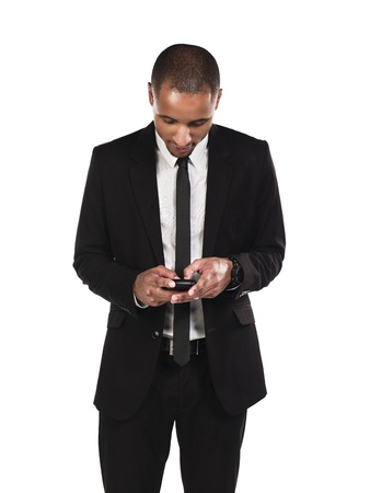 Young African American businessman text messaging against white background, Model: Kareem Duhaney Stock Photo - 17100088