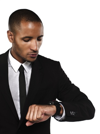 Young businessman checking the time against white background, Model: Kareem Duhaney Stock Photo - 17110676
