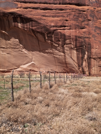 View of wooden fence with cliff in background. photo