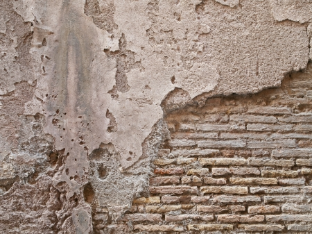 Detailed shot of cement peeled on a old bricked wall. Stock Photo - 17111991