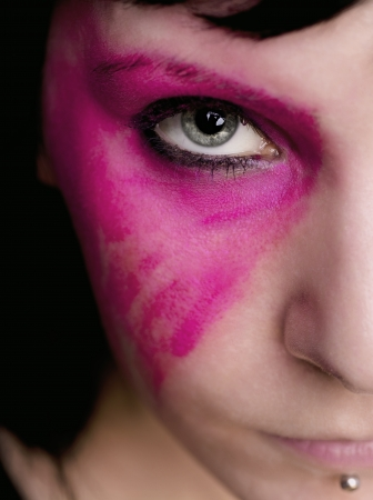 tats: A half portrait of a goth woman with heavy pink make up on. Stock Photo