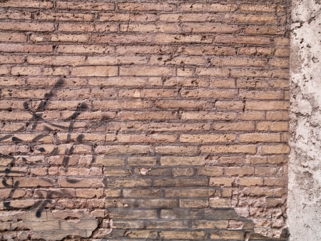 Old weathered and worn wall with graffiti on it. Stock Photo - 17118513