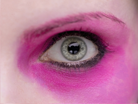 tats: A close up of an eye with hot pink eyeshadow.