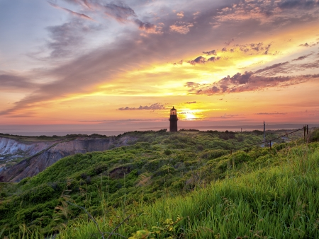 View of a lighthouse with colorful sky n the background. Zdjęcie Seryjne