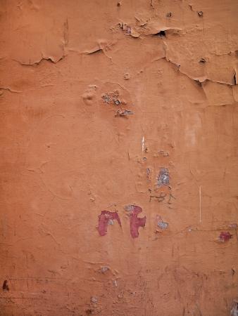 Cracked Orange Paint on Italian Wall Stock Photo - 17112484