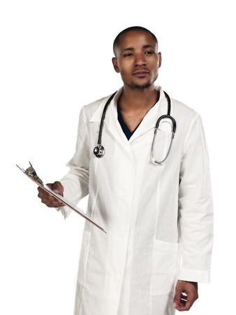 Young doctor looking away against white background photo