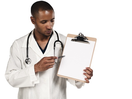 Young doctor pointing towards his clipboard over white background photo