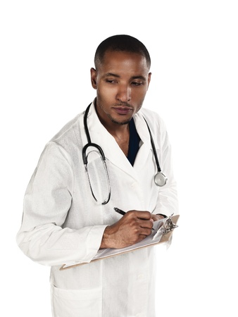Young doctor writing in a clipboard over white background photo