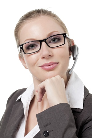 Portrait of attractive call center agent against white background photo