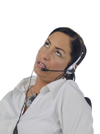 Portrait of stressed female phone operator against white background photo